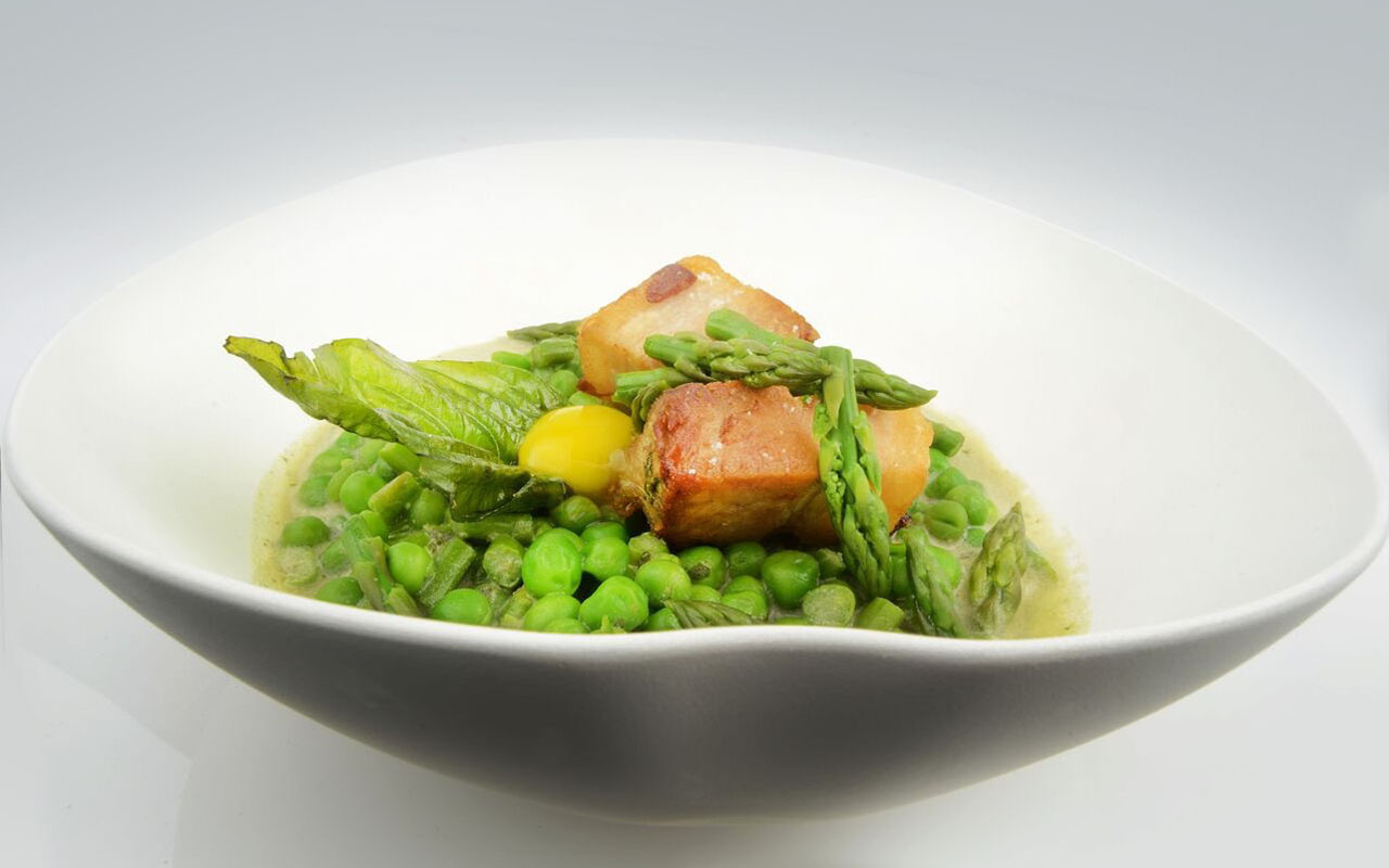 Organic Petit Pois, Green Asparagus Tips, Basil Coconut Broth, Quail Egg Yolk, Seared Pork Belly