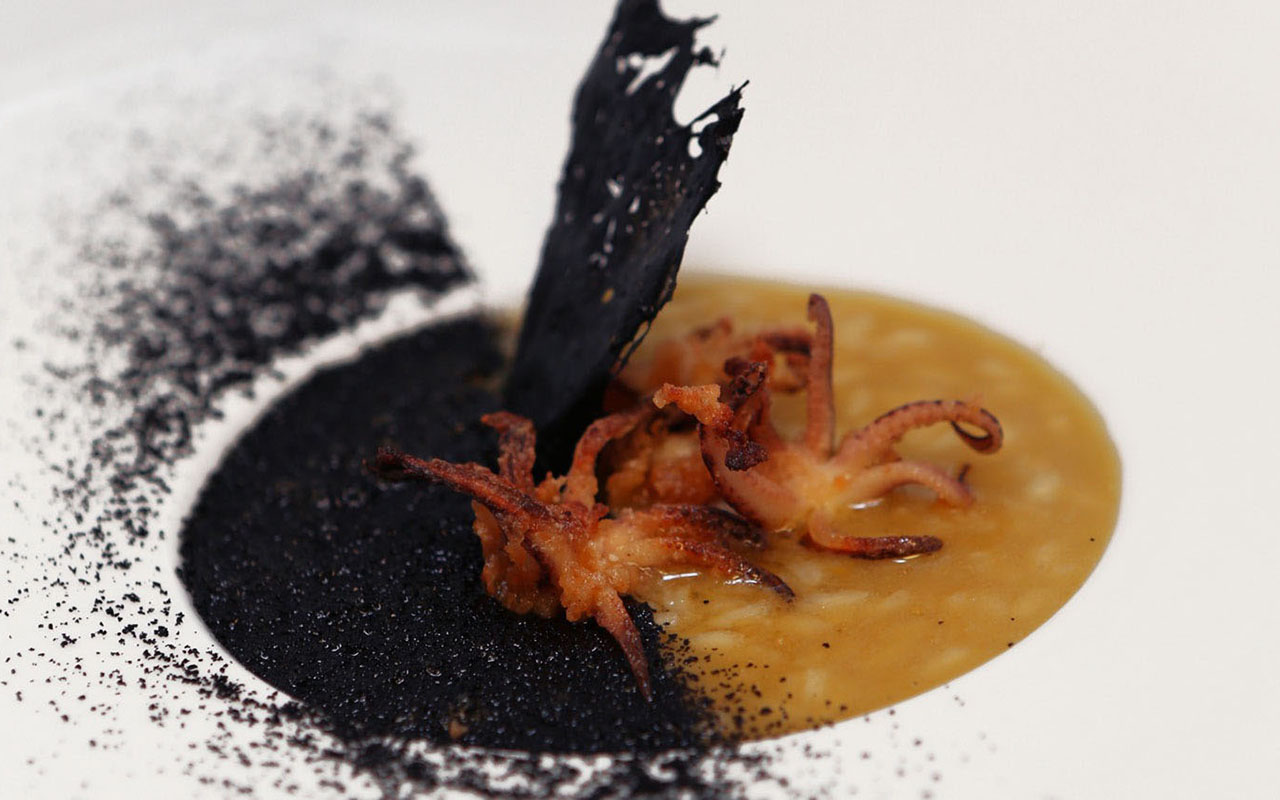 "Fumet and Olive Oil ""Dirty Rice"", Crispy Calamari, Black Squid Dust"